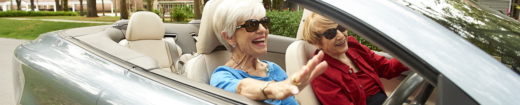 Senior women driving in a convertible