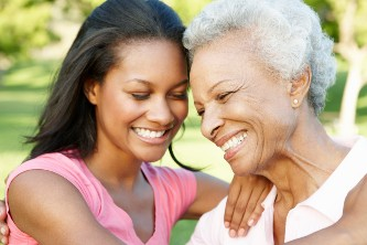 senior woman smiling with her adult daughter