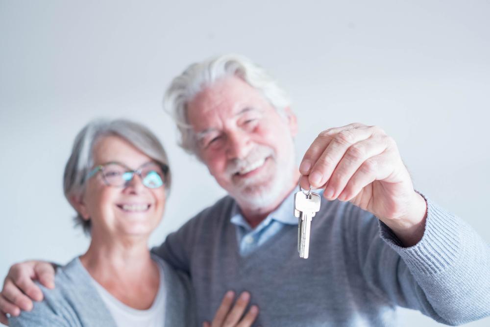 Senior couple keys to their new home